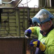 man repairing a radiator