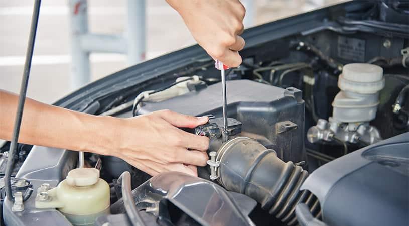 mechanic servicing engine
