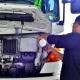 truck driver refilling water in truck radiator