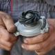 mechanic handling a water pump