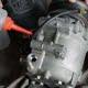 auto mechanic checking car air conditioner